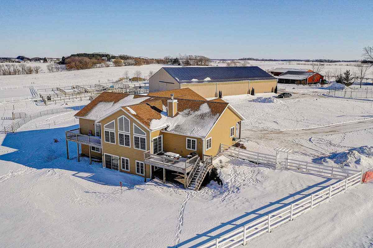 Gorgeous 5 bedroom custom built home by Parade of homes builder Wynn construction. Equestrian Farm offers: Geo thermal heating/cooling, wood flooring, granite counters, Amish built cabinetry, finished walkout LL with 2 bedrooms, bath & family room & so much more! This 35 acre Horse Farm has a 70x70 barn(2004) for horse stalls,120x60 indoor riding arena,horse washing room,upstairs break/office room(with small kitchenette and bathroom).Electric,gas,private septic for barn. Land includes 23 ac. tillable (just enough to grow your own hay) and 7 ac. pasture.  Unbelievable views-situated on a dead-end road. Just 20 minutes to DeForest, 25 to East Madison,and 15 min to Lake Wisc.