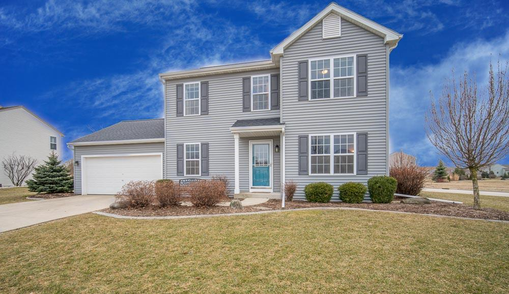 This 3 BR, 2.5 BA home is stunning inside and out. Located in the Slinger school district, you'll love the spacious layout and modern updates. The stunning kitchen has updated granite counter tops and includes tons of storage with lots of cabinets and a walk-in pantry. The kitchen opens up to the light-filled dining area and living room with gas fireplace. First floor also contains a bonus room office/den, mudroom, and laundry. Upstairs, all bedrooms have large walk-in closets. All bathrooms have been updated with granite counter tops and new tile. Other updates include new carpet in 2015, a new water heater in 2015, and a new roof in 2016. Step outside to enjoy a beautiful large yard with a stamped concrete patio, pergola, and professional landscaping. Unfinished basement is plumbed.