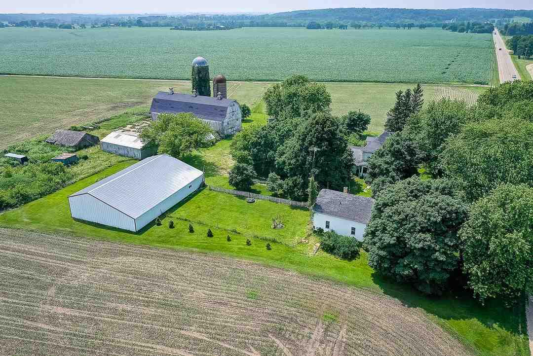 "Mark Twain once said, ""Buy Land, they're not making it anymore.""   How true that statement is!   Rare opportunity to purchase family farm of 61 years with 160 prime agricultural acres.  Approx 140 acres of tillable land and 20 acres of woods.  140 acres are currently rented for $250.00/acre on a year lease.  2 farm houses are on parcel B D 1100007. Main house with 5 BR and the rental house with 3 BR. Plenty of opportunity for additional rental income.   There are 3 parcels with this property.  Large 102x36 barn, 60x90 machine shed, and several outbuildings for all your storage needs.    Act now, never a better time to purchase farm land for the future. Contact agent for Trustee's contingency that must be written into the offer."