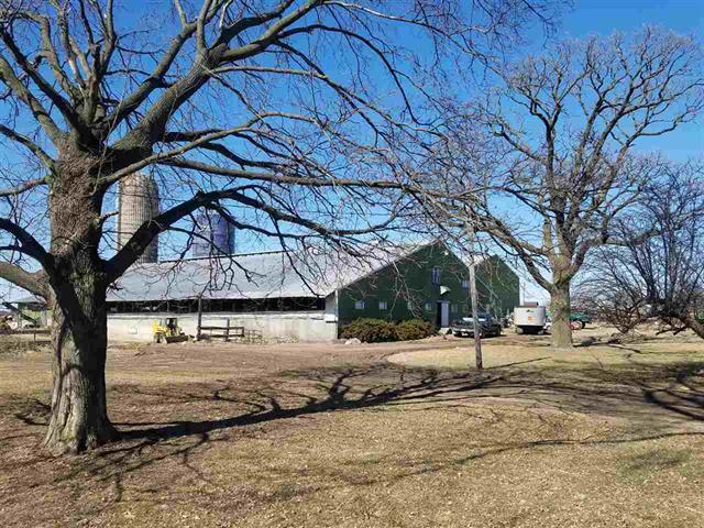 Rural property ready for some sweat equity, 4 bedroom 2 bath farm home with lots of space and a newer boiler, dairy facility consist of a double 6 parlor and 140 cow freestall barn that is currently rented month to month by a long term renter.  Large machine shed that could also be rented out or used for a business, shop, or riding arena.  Bring your imagination and make this property yours, has rental income, could be used as a dairy farm owner occupied, horse facility, space for a handyman or business owner, lots of potential. 5 acres to be split off prior to closing, additional 75 acre can be rented/purchased at later date. As Is