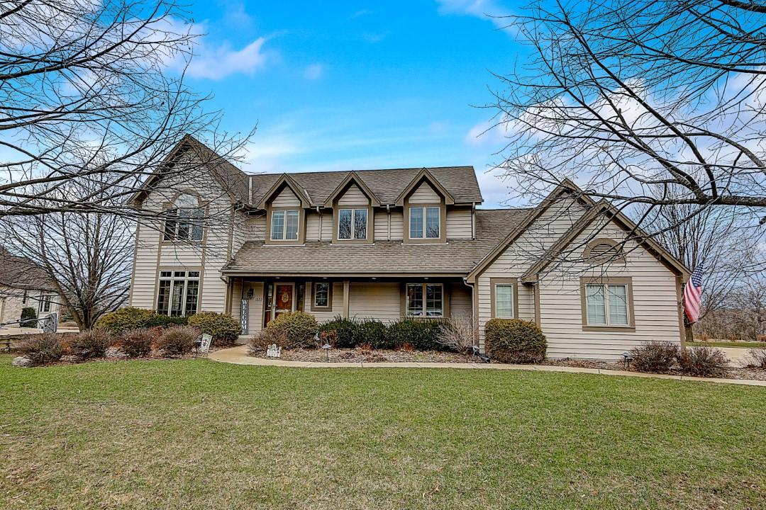 **BE SURE TO VIEW THE ''Walk-Thru VIRTUAL TOUR''**  Wonderful home in popular Tallgrass Subdivision will meet all your needs!  5 Bedrooms, 3.5 Baths, 3 car garage, 1/2 Acre Lot -- shows beautifully! Hardwood floors, high-end kitchen appliances, crown molding, vaulted ceilings, GREAT floorplan. Updates include: all cabinets/doors/woodwork professionally painted; Quartz countertops in Kitchen; high-end kitchen appliances; back entry Mudroom remodel; updated light fixtures, many rooms freshly painted; installed pet electric fence. Great location with easy access to I-94.  Agents please abide by COVID-19 protocol noted in Private Remarks.