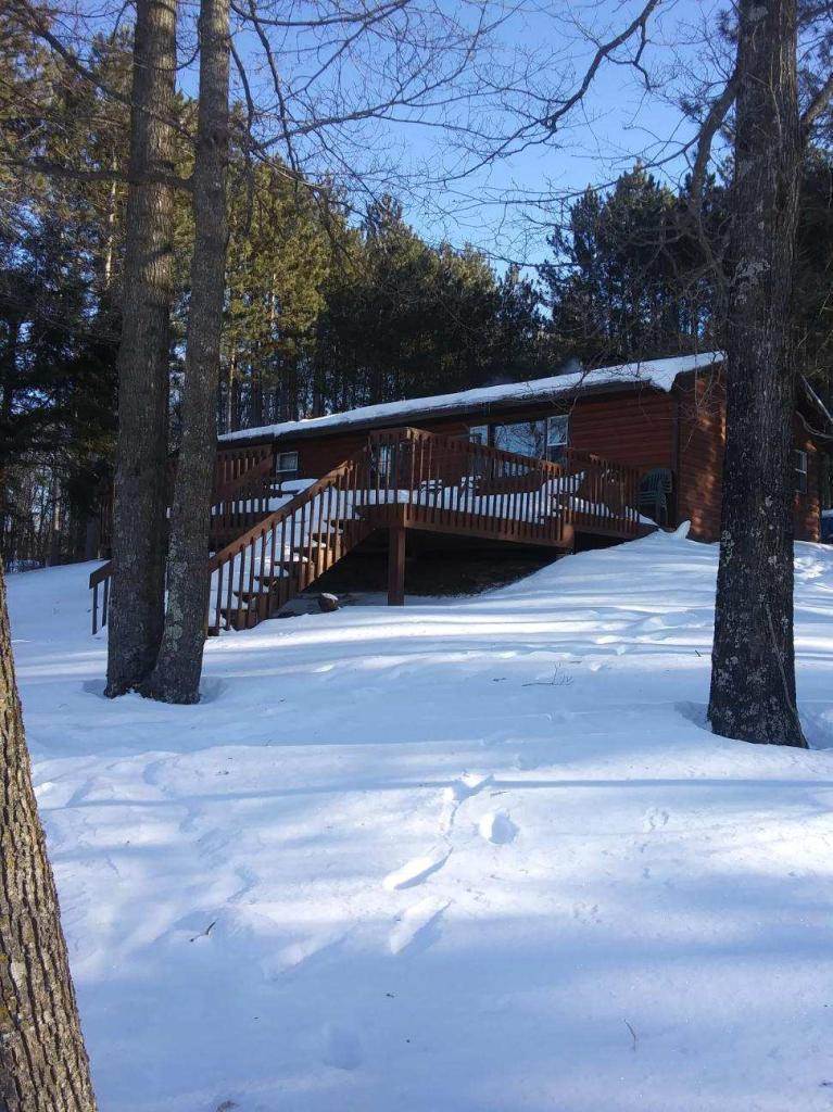 Looking for that special waterfront property ?Up North??  This inviting property on Lake Winter is it!  Located on the end of a dead end road, this property offers that maximum peace and quiet. Enjoy the sunsets off of your huge lakeside deck or tinker in your oversized garage.  This log sided home has the perfect elevation to the lake with a large yard lakeside. Keep the chill out with the woodburning fireplace in the living room.  Having one bath and two bedrooms, this is the right property for either a year round home or waterfront cabin on beautiful Lake Winter.  Welcome to the North!