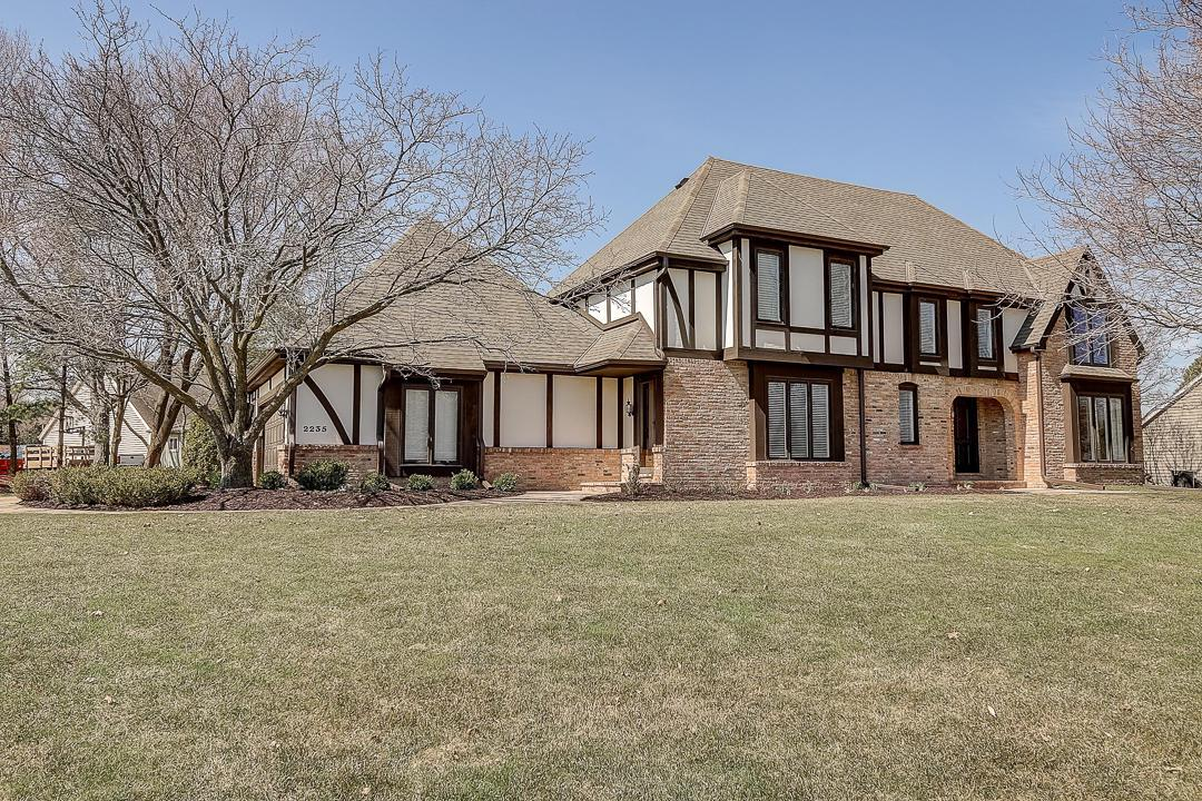 Out of state job transfer makes this Custom 4BR/3BA Tudor w/ storybook details & countryside charm in the heart of Brookfield available. Chef's kitchen w/ Granite & Quartz counters, Marble back-splash, state of the art appliances & unobstructed views of the DR, LR, & Den. Cathedral ceilings, varied plank size HWFs, & brick accent wall speak of the design detail in this custom home. Master Suite retreat w/ walk in rain shower, jetted soaking tub & WIC. BRs are generously sized w/ Cathedral ceilings & flooded w/ natural light. Main floor office (potential 5th BR), Full BA, laundry, & Storage lockers. Many updates throughout; Epoxy GA floor, New carpet, 5 New windows, 3/4 Main floor bath renovation. Washer & Dryer (2020) Kitchen & Family RM Patio doors (to be installed) & so much more!