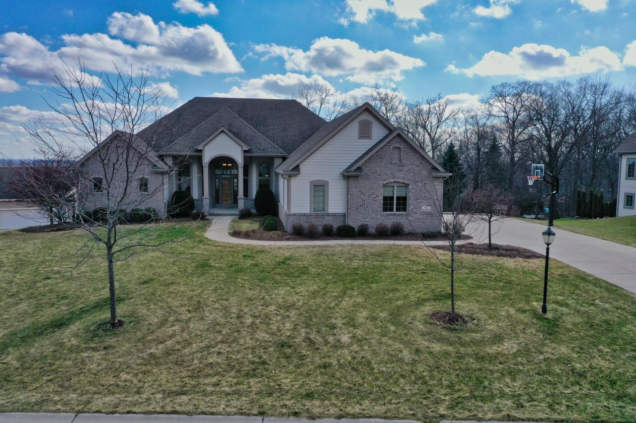 Prepare to be amazed by this spectacular exposed Ranch in the sought after Taylors Woods subdivision! Quality built Victory home w/spacious and inviting open floor plan. Huge great rm w/gas FP opens to eat-in kitchen w/SS appliances, granite, walk-in pantry, center island, breakfast bar & deck access. Master suite includes his/her closets, jetted tub, tile shower & dual sinks. 3 additional bedrooms, Jack 'N Jill bath + 1/2 bath, utility room with laundry & dining room/office with French doors complete the main level. Lower level includes 5th bedroom, walkout to gorgeous patio w/picturesque professionally landscaped yard with in-ground trampoline, full bath w/laundry & workout room. Incredible space to make your own. Plumbed for wet bar.  Top schools including Blue Ribbon Marcy Elementary!