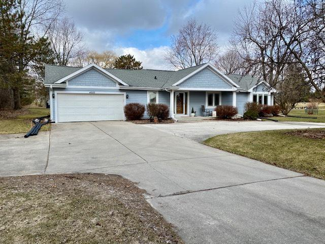 Stellar 4BR, 2.5BA ranch w/2700 sq ft on nearly 2 ac. A rather recent renovation gives a modern feel w/many amenities you would expect to find in new construction. Open concept KIT w/SS appliances, center island, snack bar, wall oven, cook top, large walk-in pantry. Great space to entertain; offers a user-friendly flow. Large dining rm will fit most tables and is open to KIT. Huge great room w/impressive NFP. Main living areas are generous in size and offer HWFs. Master retreat offers an over-sized WIC w/strategic cabinetry, tiled shower, soaking tub, dual sinks. Huge laundry/mud rm off garage entry next to .5BA. Triple pane Pella windows! Inviting foyer & a screened porch overlooks private back yard. Circular driveway for off-street parking & bonus parking stalls. Excellent curb appeal!