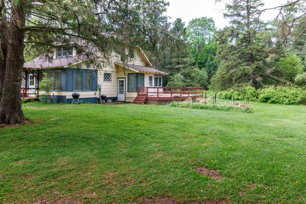 Exceptional opportunity to own 318 acres of mature hardwoods and pines, with approx 60 acres of tillable land. The 3 bedroom, 2 bath house has been well maintained and remodeled blending vintage farm house appeal with updated amenities. Buckley Creek meanders through the property and is an official trout stream. Several outbuildings including a 3-stall horse barn. Possibilities as trophy hunting land, hobby or equestrian farm. A beautiful private location less than an hour to Duluth/Superior.