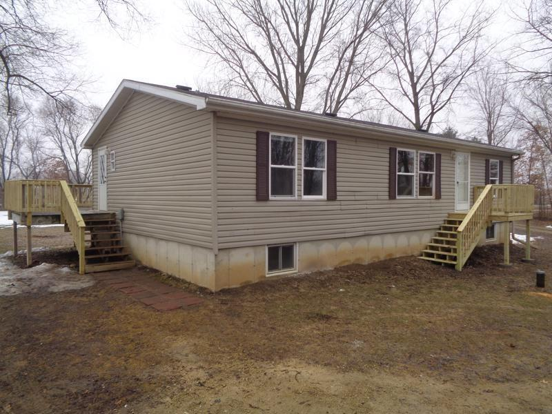 3 Bedroom, 2 Bath Elk Mound Home For Sale. 40 Acres on 2 parcels of land. Previous owner had chickens, horses, and a couple of beef. New Flooring. Property has creek, and tons of wildlife! Agent Owned.