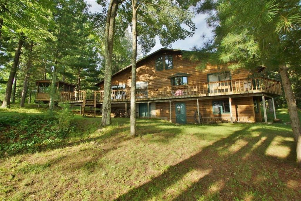 Big Sissabagama--Looking for privacy and acreage on a great fishing and recreational lake? You'll love this charming property! The 3 bedroom, 2 bath cabin is situated on a lot of almost 9 acres in size, is heavily wooded with paths throughout the pine forest, and enjoys 600 feet of shoreline with stellar lake views. The property has easy elevation to the shore and there's not a neighbor in sight. The cabin has all essentials on the main floor including a bright master suite and laundry room. The living room with wood burning stove has a nice northwoods feel. The unfinished walkout basement has in-floor heat and is great for storage or could be finished. The gazebo located off of the lakeside deck has great lake views and is a nice space to spend lazy afternoons. The private parcel has potential for adding building site(s). 24x44 pole building. New septic tank 2018. Big Siss has a full restaurant with a great fish fry! Some lake restrictions before 10am and after 6pm.