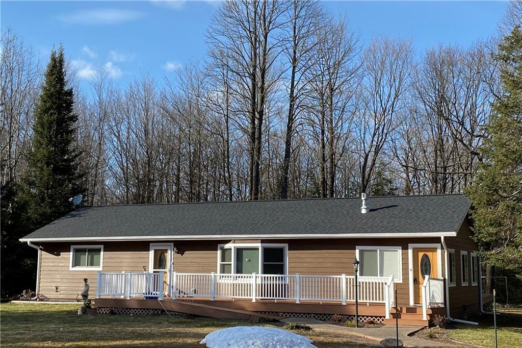 Wonderfully updated, no maintenance country home set on 5 acres! This home has plenty of space with an open feeling! There is a fieldstone gas fireplace in the living room and a 3-season porch that could be easily converted to a family room with just adding a heat source. The lower level offers a nice family room with exit to the outside plus two non-conforming bedrooms, and a full bath with jet tub. Plenty of closets and storage space. Additionally there is an oversizedtwo car detached garage with a workshop and more storage space. Zoned agriculture, horses or a hobby farm would work here!