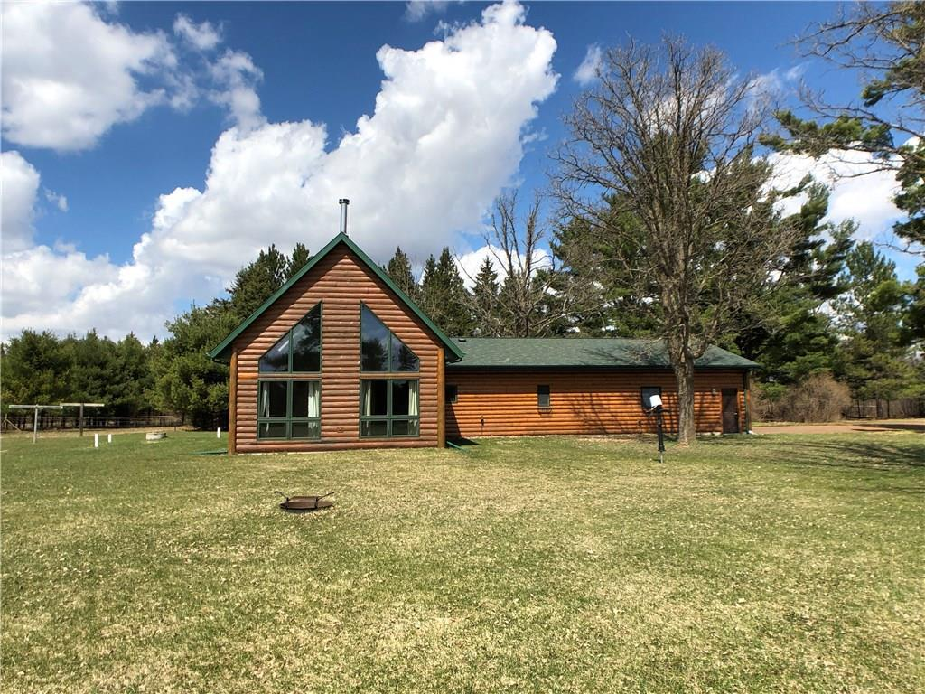 Newer all one-level home on 80 acres; 73 acres of MFL closed and approximately 7-10 acres of fenced open land. The home features in-floor heat supplied by either an outdoor wood stove or indoor propane boiler plus a free-standing wood burning stove in the great room. Master suite includes jacuzzi tub and 14'x5' walk-in-closet. The dirt floor pole shed is 48'x32'x14' with 14'H x 12'W doors with two horse paddocks. There is a portable 72'x30' greenhouse for those who enjoy gardening. In addition to the drilled well there is a sand-point well to aid in gardening or watering your livestock. The attached garage is large enough to include a small work-shop. First time offered. Property with less acreage is also available. See MLS#1546216