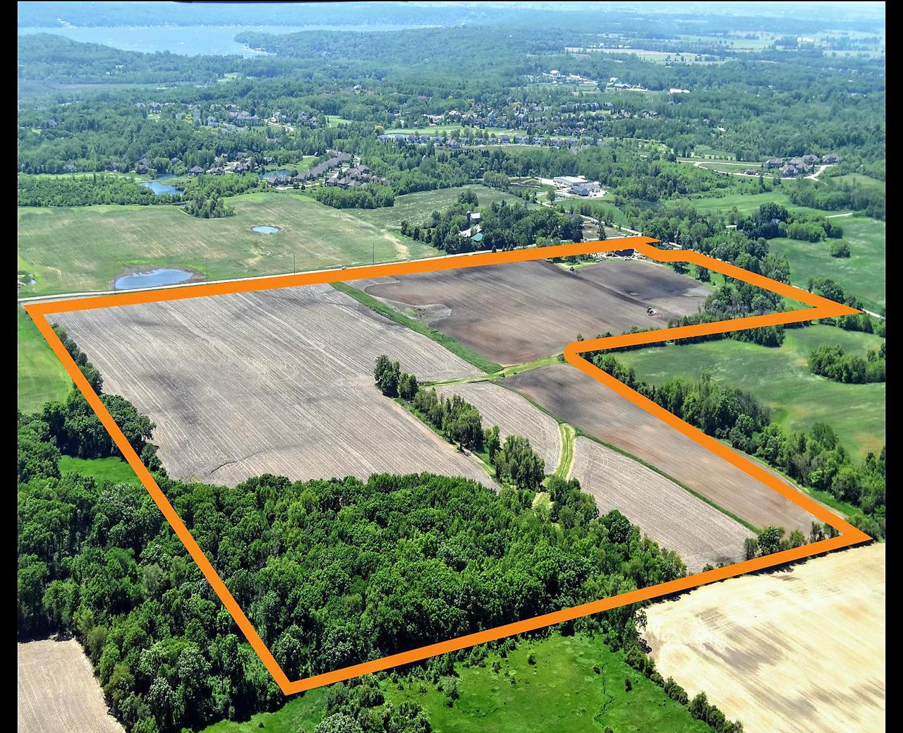 THIS PROPERTY HAS IT ALL!! 118+/- acre farm. 94+/- tillable acres (zoned A1) with drain tile throughout. Currently leased for 2020 crop season. 60x40 and 40x56 pole buildings, 4 bedroom house and buildings being sold AS IS CONDITION.  House needs some work and updates but very solid structure. Well maintained 8+/- wooded acres (zoned C2) with mowed trails, mature trees and hardwoods Property is full of wildlife and outdoor recreation, mowed pasture land with pond. Property is also being divided and sold as 35+/- acre proposed buildable sites. MLS#'s 1644671, 1644672. Located close to Lake Geneva, Delavan Lake, Lake Como and Geneva National! This property has been in the family for over 100 years. A MUST SEE!! Very easy to walk the property. Easy access to Interstate 43, Highways 12 and 50