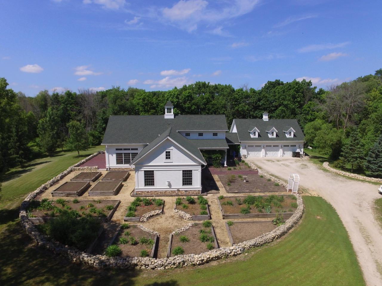 Quiet parklike seclusion on 50 acres surrounded by open farmland, ponds &wildlife. Features a 2012 Thelen Greek Revival style 5000 sq.ft customdesigned home totally accessible inside and out with a 3 level elevatorand raised garden beds. Master wing includes an office & fireplace.The property also includes a custom designed working horse facility w/ indoor arena and built in apartment for employees or family. Easy maintenance poured concrete stalls, radiant heating, 8 grass paddocks, loafing sheds, hayfield and outbuildings w/large RV storage. Easy commute from Milwaukee, Kenosha & Racine.