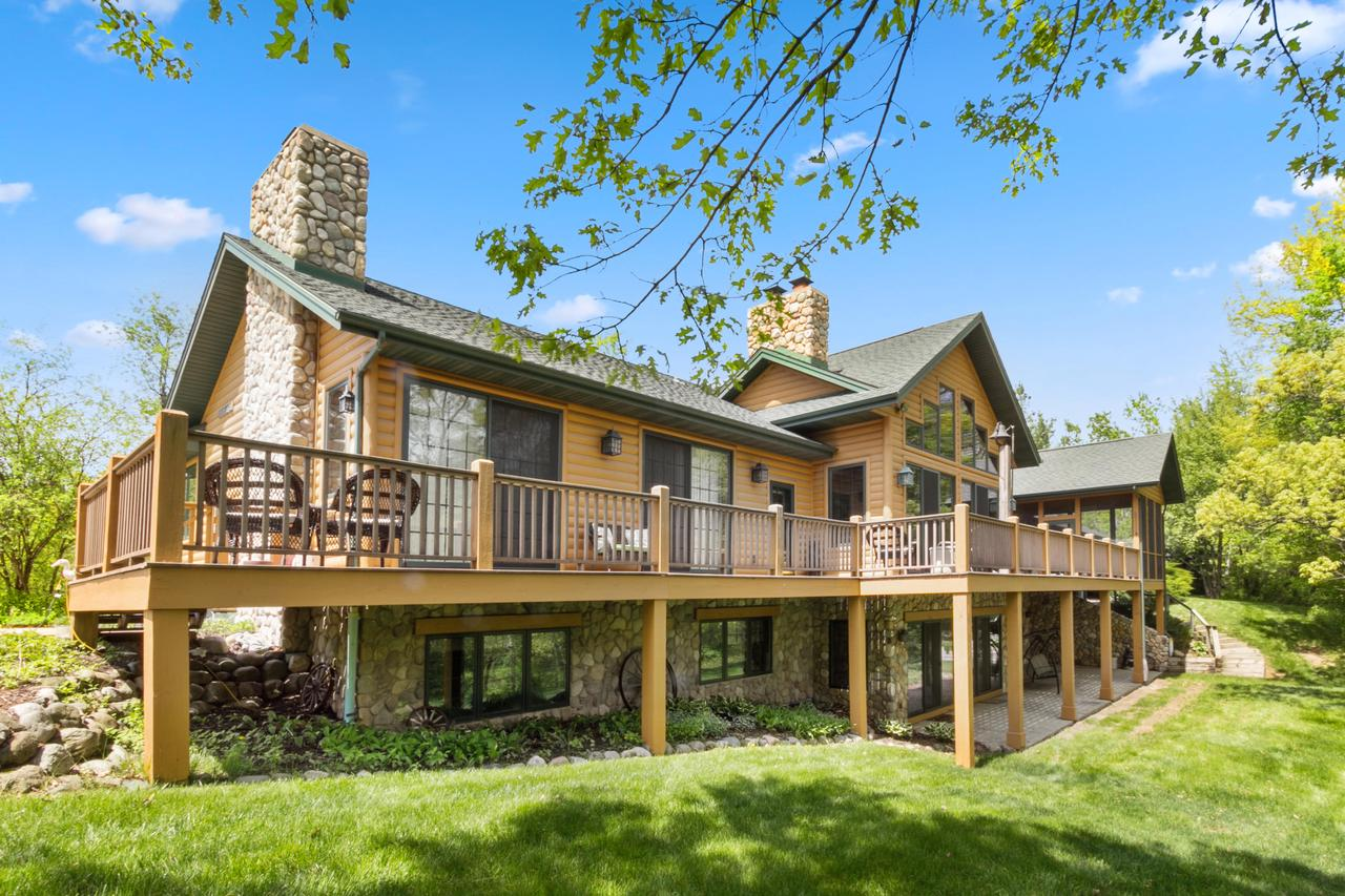 Spectacular 5BR, 5.5BA Log Lodge w htd pool overlooking a 4 Ac pond on 43 acres of rugged beauty teeming w fish and wildlife.  A true sportsman's paradise, first class all the way. You'll be wowed by the grandeur of the lodge style great rm w FTC windows, loft, stone FP, HDWF's, and granite kitchen, plus 1st flr master, screen porch, LL W/O w Fam Rm, 4BR's, 2BA's, htd 3 car garage, and 30x45 Pole Bldg for all your toys and barn parties. A network of trails winds you around the pond, thru hdwd forests, cultivated fields, and  a shooting range to sharpen your skills. Enjoy the beauty of the season's, from fall's colorama, to winter's snow laden pines.  Zoned for horses, outbuildings, recreational vehicles.   ''Sugar Creek Estates'' is a 7 lot development (5-8 Ac ea) for future appreciation