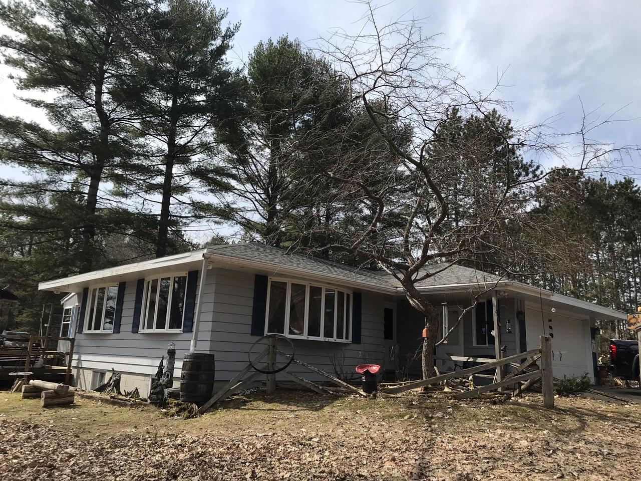 MENOMINEE RIVER- WORK FROM HOME .  90 ft frontage with sandy bottom, 1.43 acres,  3 bdrms, 2 1/2 baths. Main floor has open concept large living room /dining room,  with beautiful view of the river. Cozy siting/TV room with wood burning insert  fireplace, roomy kitchen.    Great for fishing, kayaking, swimming. Four seasons room to enjoy just off kitchen. 2 car attached garage with  basement and main floor entry. Finished basement with bar area,  family room, hot tub. & 1/2 bath.  Electricity at shore for  lighting up your play area. Newer roof, water heater and furnace updates.  Awesome for entertaining.  Barn 25X32 with stalls for 3 horses and fencing.ASTREA Satellite Internet Available