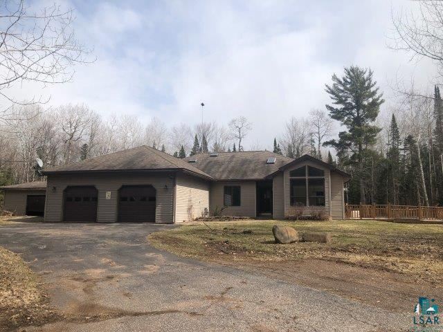 Large three bedroom, two bath home with two car attached and one car detached garages, huge wrap around deck with sunken pool, shed, outdoor wood heat, kitchen has tons of space, fireplaced family area, living room, laundry room, and all on 1.1 acres.