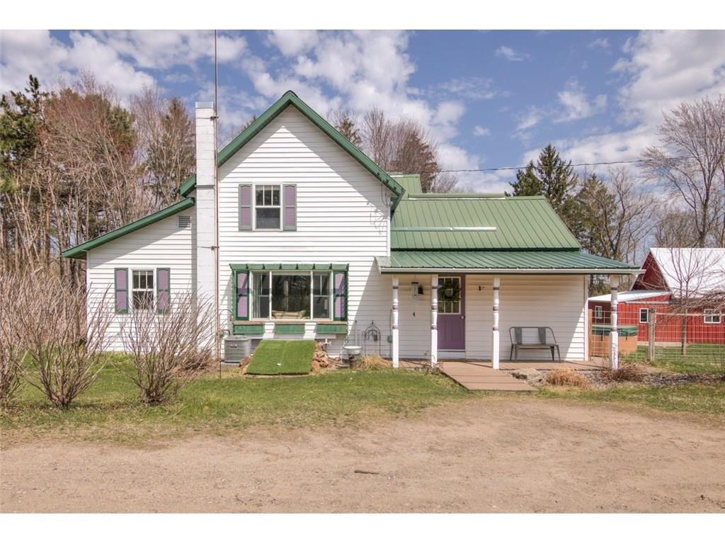 Charming Hobby Farm located minutes from Eau Claire.  Peaceful, 4 bedroom/2 bath farm house with great style! New air conditioner in 2018. New concrete in garage Fall of 2018.  New Granite countertops and back splash in kitchen.  Fresh paint in every room.  New Water Heater and Furnace in 2019.  New light fixtures in every room.  New outdoor space for chickens (chicken run) that's attached to the coop.  New vanities/toilets/lights in both bathrooms.  Shiplap in master.  Hutch in living room and hot tub included. MUST SEE!!!