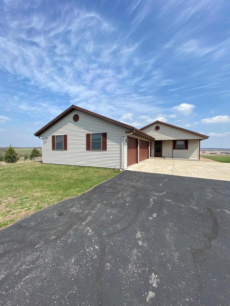 Country living at its finest!  4BR, 3Ba walkout ranch on 50 acres with never ending views.  It's the perfect place to hang your hat!  A gated entrance and long paved drive gets you back off the road.  The house features a 3 car attached garage and 2 huge Cleary buildings.  Zoned A1, there is plenty of ground to farm or graze horses or cattle.  One 42 x 90 barn has 3 paddocks and tall enough to store the camper.  The other is 30 x 70 with concrete floor, a small office and plenty of room for all your toys and tools.  The property is a perfect mix of functionality and fun.  Bordering the Turtle Creek Wildlife Area, deer, ducks, geese and even wild pheasant are commonly seen here.  3 tower blinds stay with the property and await the new owner.  This is a must see that will not disappoint!