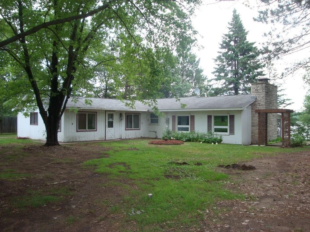 Awesome level frontage to Bass Lake.  One level floor plan with nice deck facing the lake.  This two bedroom one bath is ready to be customized to your liking.  Large detached garage and outbuildings for plenty of storage