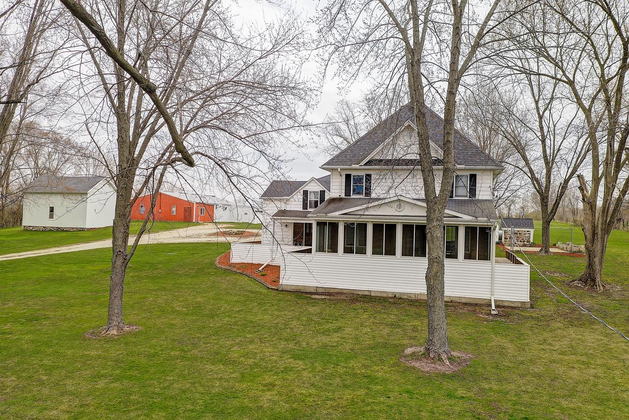 Country Estate features an updated 4 bedroom home, several outbuildings and 5 Acres of land offering endless opportunities for country living, recreation, animals, crops and privacy.  You'll love the addition and renovations done in 2008 offering over 3600 sq feet which includes kitchen and laundry updates and allows separate bedroom and family room areas and an attached garage.  Enjoy the views from 2 enclosed porches.  2 Barns, a Potting Shed and level acreage for crops or recreation.  Note: 3D Tour in Video to walk through house on-line.