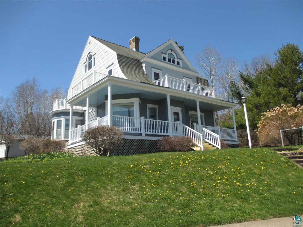 In 1905 a prominent Bayfield entrepreneur likely chose this site for its dramatic location, overlooking the natural harbor, Lake Superior and Madeline Island. Walking distance to downtown, this historic home has a classic feel inside and out. High ceilings, hardwood floors, open staircase plus a hidden one! There's a grand living room with a lake view window seat where you'll soak up the sun. Formal dining room has large bow window capturing the awesome view. With 3 bedrooms, office and a bonus room ready to finish as a master bedroom suite or home office, there's plenty of space. Beautiful wraparound porch plus 3 upper porches brings the Lake to you! Attached, heated oversize 2-car garage is project-ready. Big unfinished attic has 3 sets of lake view windows. Best of all, you're so close to the water and the heart of the Bayfield community. Come take a look!