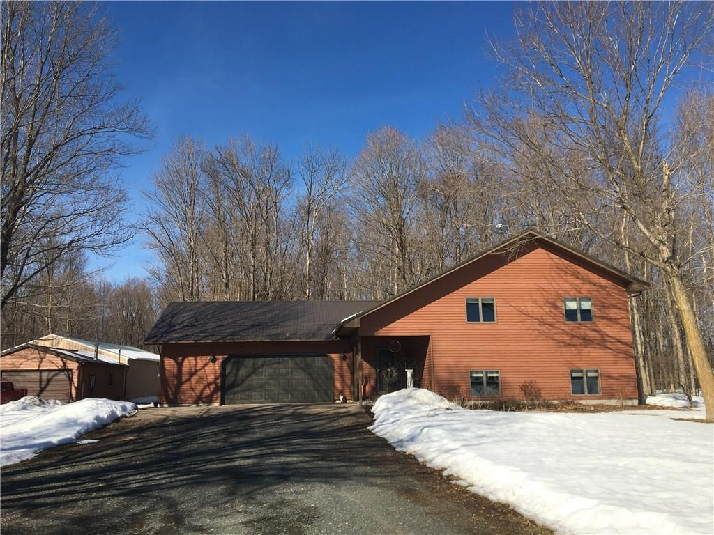Well cared for. Move in ready on 80 beautiful acres! This home offers four bedrooms with an open concept living. Low maintenance exterior with a steel roof installed in 2018. Well built home with Andersen Windows all around. Country living at its best with insulated work shop connected to a 40x56 pole shed that is set up for horses. Great hunting land with trails throughout and permanent deer stands included. Large lower level family room features a gas fireplace. Enjoy nature from your deck.