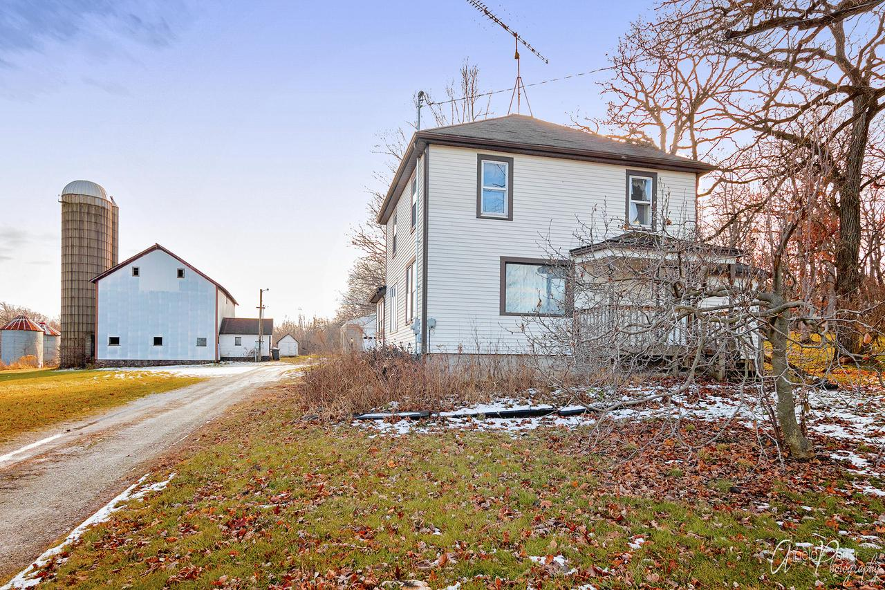 RURAL LIVING AT IT'S BEST! This Serene piece of property has it all w/5 Acres, Oversized Barn at 52' x 31', Huge Garage/Workshop at 40' x 36' w/water & gas pipe hookup along w/220 electric  & 2 Outer Doors at 9.5' and 7.5', two additional Outbuildings including a 125' x 18' Storage Shed and 20' x 10' Building that was used as a Granary, 3 Beds /1 Bath American Farmhouse w/Eat-In Kitchen, Spacious Living Room w/Built-In Cabinets, Dining Room, and Large Sunroom, 3 Beds on the 2nd Floor, Full Basement, Gas Forced Air Heating along w/Central Air, 220V Electric Available along with a 2 Car Detached Garage, Property is zoned Residential, Horses allowed but please check w/Village of Bristol, Close to I94 & Shopping, Property is adjacent to Bristol Woods County Park, Bring your ideas, Sold ''AS-IS