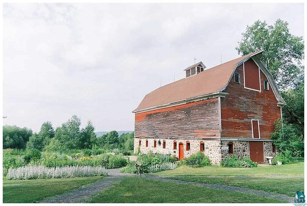 Rare opportunity to live on and own an operational 40-acre berry farm and apple orchard. Charming farmhouse, historic barn, sauna building, meditation yurt and so much more. Property located at the South entrance to the Bayfield Fruit Loop with views (and lakeshore breezes!) of Lake Superior. Delicate micro-climate has nurtured and sustained the organically-grown blueberry ad raspberry fields and apple orchard. Two-story traditional home features five large sleeping rooms, two baths, open concept kitchen, dining and living room and fenced in garden area overlooking the farm. Barn provides retail and storage space. Pole barn and detached garage provide both parking and additional work space. Land has been immaculately and respectfully cared for over the 30+ year ownership. The ever-changing landscape and blooms year-round create a magical escape one would dream of calling home.
