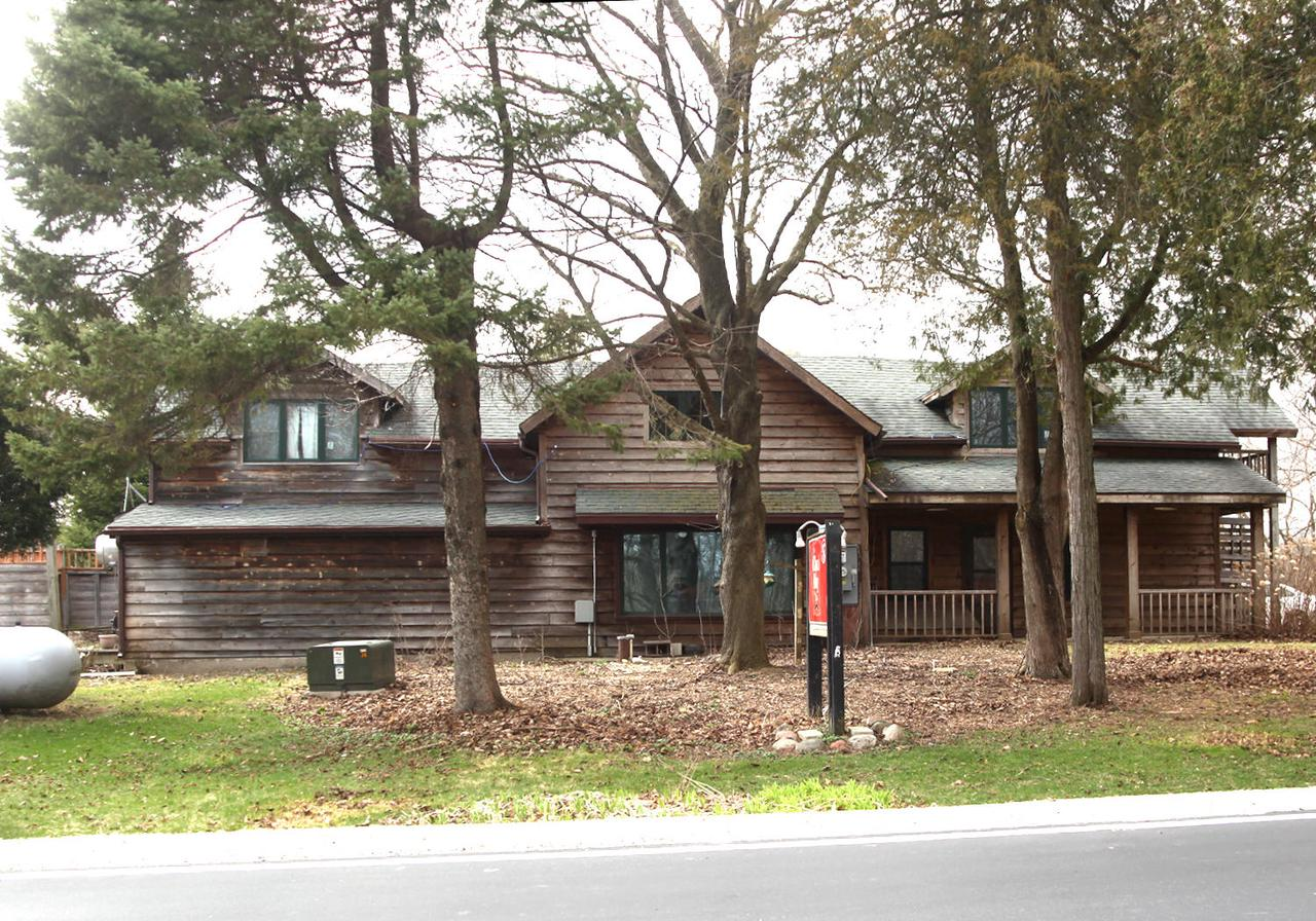 Restored in 2002.  Configured as a restaurant on the 1st floor & one bedroom rental apartment on the 2nd floor with separate entrance. Beautiful location surrounded by the Kettle Moraine State Forest. Public access to Forest Lake across the road,  walking distance to Mauthe Lake.  Snowmobiling, hiking &  horseback riding trails are behind property.  Restored to original era with log walls inside, stone fireplace & stunning oak bar. Restaurant, turn key ready or convert to a residential property.   White oak floors, vaulted ceiling, new electric, plumbing & restaurant equipment induced.  extra storage, barn/out building, everything in it as is.  Call today for more details. Seller request that listing agent or partner Tracey be present at all showings.