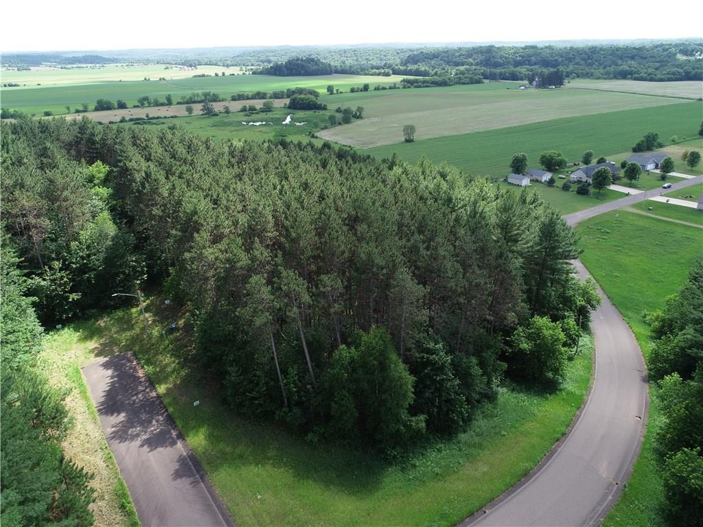 This residential lot is located in Prairie Farm's beautiful Whispering Pines Subdivision on the south end of town. There are 6 remaining lots, mostly wooded w/ tall pines. Choose your ideal location & lot size. Enjoy excellent views of the countryside, many with perfect elevation for a walkout basement. Prairie Farm is an amazing community located on the gorgeous Hay River w/easy access to Hwy 53, I94, Hwy 25 &Hwy 64. All lots (except lot 14) have city sewer & all have electric. Price Reduced!