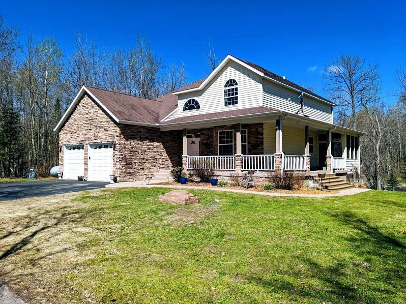 Dream home in the Northwoods! This spectacular 4BR/3 1/2BA home sits on 2 lots tucked back in & off the road. Sitting on 460 ft of frontage along the Thornapple River, this one offers a tranquil setting like no other. Home is nothing short of large, offering an inviting layout from the entryway, dining room, kitchen, dining area, living room & towering open staircase. Main floor BR inc a bathroom suite w/tub & tile shower, living room stone fireplace, screen porch & bonus 2 car detached garage.
