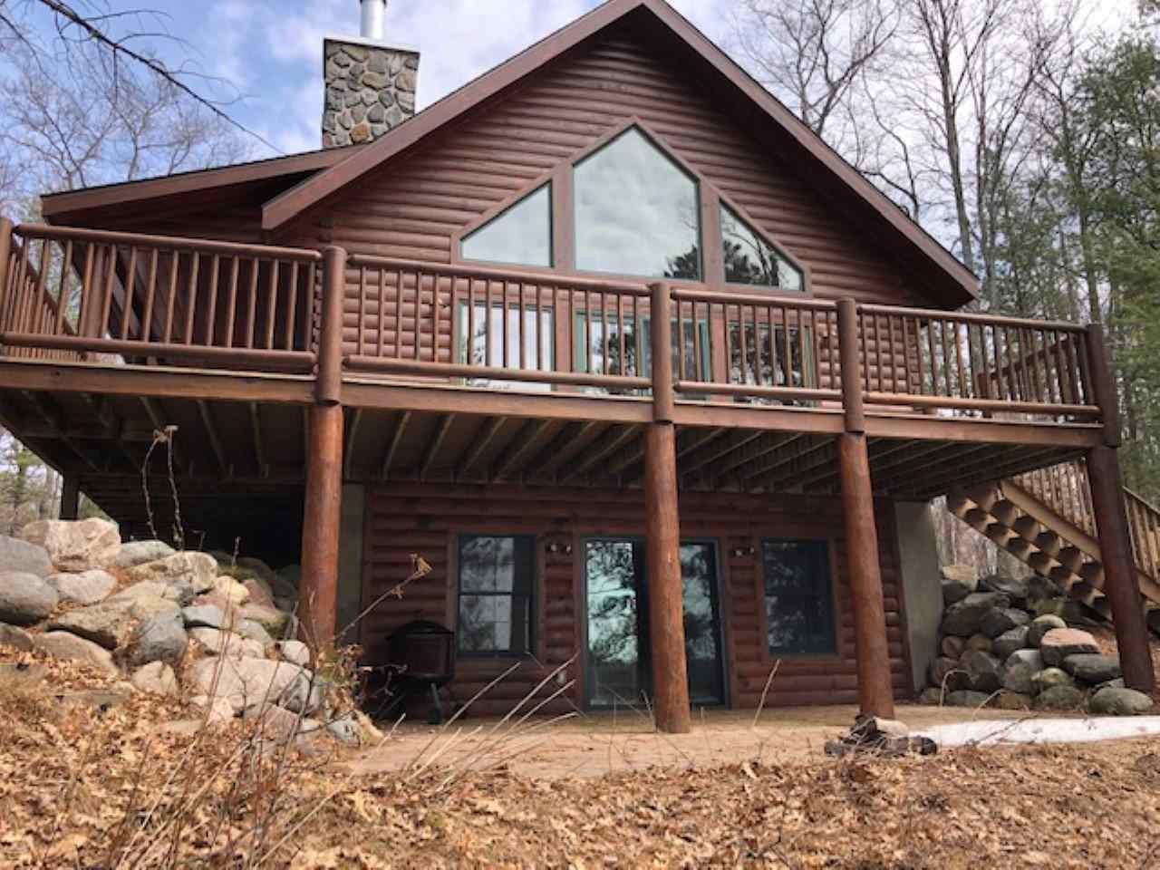 First time offered!  Gorgeous sunset views on beautiful Horsehead Lake!  A combination of rustic style & modern luxury in this Full Log Northwoods home.  Meticulously maintained Chalet style property with a modern open floor plan.  Relax in the living room with vaulted ceilings & naturally checking log beams, next to the hand crafted stone wood burning fireplace.  Open kitchen with built-in Jenn Air range and large breakfast island.  Handcrafted wood cabinetry, main floor laundry, Kohler steam shower plus a separate soaking tub!  Loft area is perfect for a den/reading area overlooking living areas.  Fully finished walk-out lower level with a family room area and custom built wet bar.  Plus a full bath and bonus room for overflow company.  High efficiency boiler for in-floor heat throughout all 3 levels of the home keeps it warm and cozy, plus it features central air for the warm summer nights!  Step outside to a large open deck overlooking the water and watch eagles fly right over your head!  The deck also connects to a 45x8 covered porch.,Both porch and deck have maintenance-free decking material.  Beautiful wooded expansive lalndscaped yard with a high quality children's play set.  Two car detached garage with large loft area for additional storage.  Blacktop driveway with extra parking areas. Just minutes from downtown Lake Tomahawk!  Come and see for yourself, just how much this stunning property will exceed your expectations!  Directions:  Hwy 51 North to Right on CTH D (by Hazelhurst Pub & Grub) East on CTH D to Hwy 47, South 1 mile to Right on Crow Road, property is at the end of road.