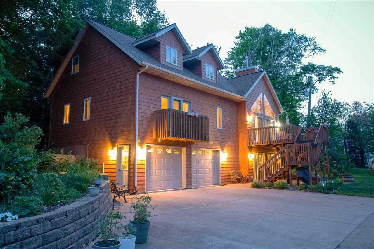Beautiful, perfectly maintained, 3 bedroom 4 bathroom on private North Harper Lake, off of Rustic Road #1 just outside Rib Lake!  This lakefront getaway includes 2 lots(W3102 and W3097) with 2 docks and 140 feet of shoreline.   Three levels provide 2800+ sq/ft of living space!  The upper level includes 2 bedrooms a full jack-and-jill bathroom, 2 large walk-in closets and a bonus loft. The open-plan main level boasts a vaulted ceiling and a gas fireplace in the living room, 2 sets of French doors leading to large deck, a 3-season porch off of the dining area and a large master bedroom with a full bathroom, walk-in closet, additional linen closet and private balcony.  A laundry room, half bath and 5x10 pantry are all on the main level as well! The lower level includes a drive-under 2-car attached garage, family room, den with a large closet, full bath, utility room and under-stairway storage, as well as ceramic tile floors with in-floor heat!  French doors open to a large patio. There is also a newly-sided 1-car detached garage, a garden area and a large perennial flower garden.