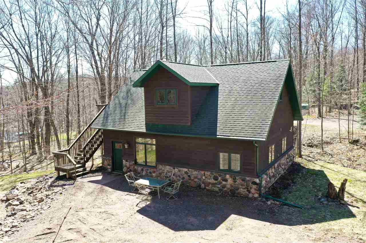 Cedar sided 3 bedroom, 1.75 bath lake home or cabin on beautiful Kathryn Lake. Open concept design with high ceilings. Kitchen with large island/breakfast bar. Main floor bedroom and full bath with laundry. Upper level bedroom with wood floors and deck access. Forced air lp furnace and central air. Drilled well and holding tank septic system. Nicely wooded +/-1.53 acre lot with approximately 105 feet of water frontage located on a semi private dead end road. The property is located on the atv/utv route and close to the snowmobile trail system, Chequamegon National Forest and Perkinstown Winter Sports Area. Kathryn Lake is +/-63 acres and has a max depth of 58 feet. The stove, refrigerator, washer, dryer, window treatments and yard shed are included in the sale price.