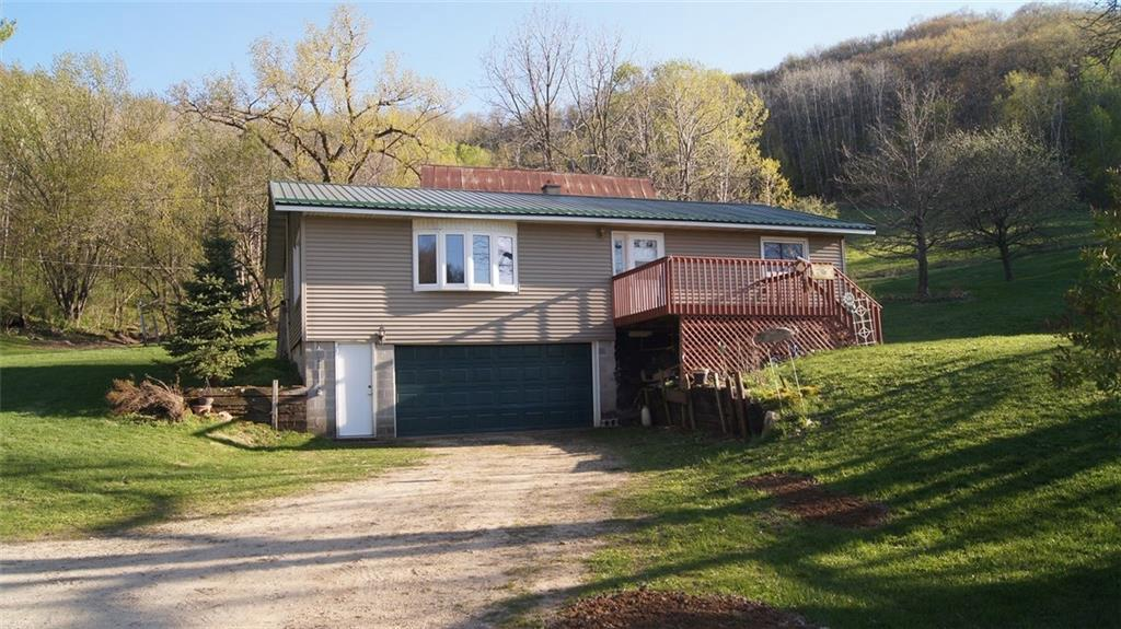 Beautiful 3 bed, 2 bath home located in the scenic Waumandee Valley area. Lots of deer sign throughout the property. Many old growth apple trees and a couple food plot locations for hunting. There is also an additional home, barn and 40x60 Morton Pole Building on property. Property is enrolled into Closed MFL for timber management, wildlife habitat and reduced taxes. Taxes and acreage are approximate. Property is about 20 min. from Arcadia and 40 min. from Winona.