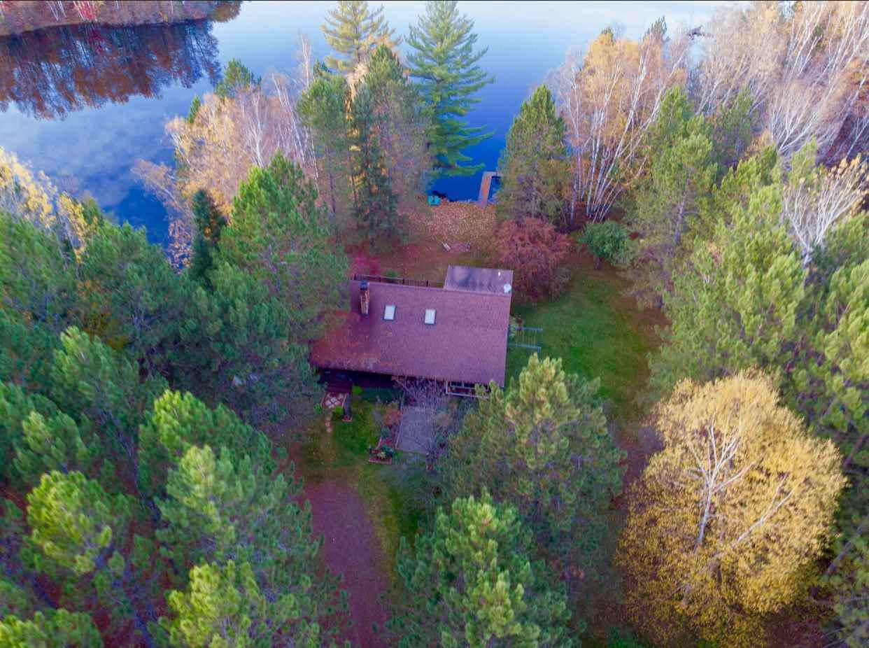 Looking for a rustic escape to take the family and get away from it all?  Look no further!  Secluded down the rustic roads of Mall Lane in Medford, this well maintained log home sits on 8+ acres with plenty of room to explore and have your own private access to Lake Romeo as well.  You'll be sure to feel connected with nature in this home that makes it easy to incorporate the outdoors into your living quarters.  You'll be spending most of your time on the covered front & side porches or three seasons room!