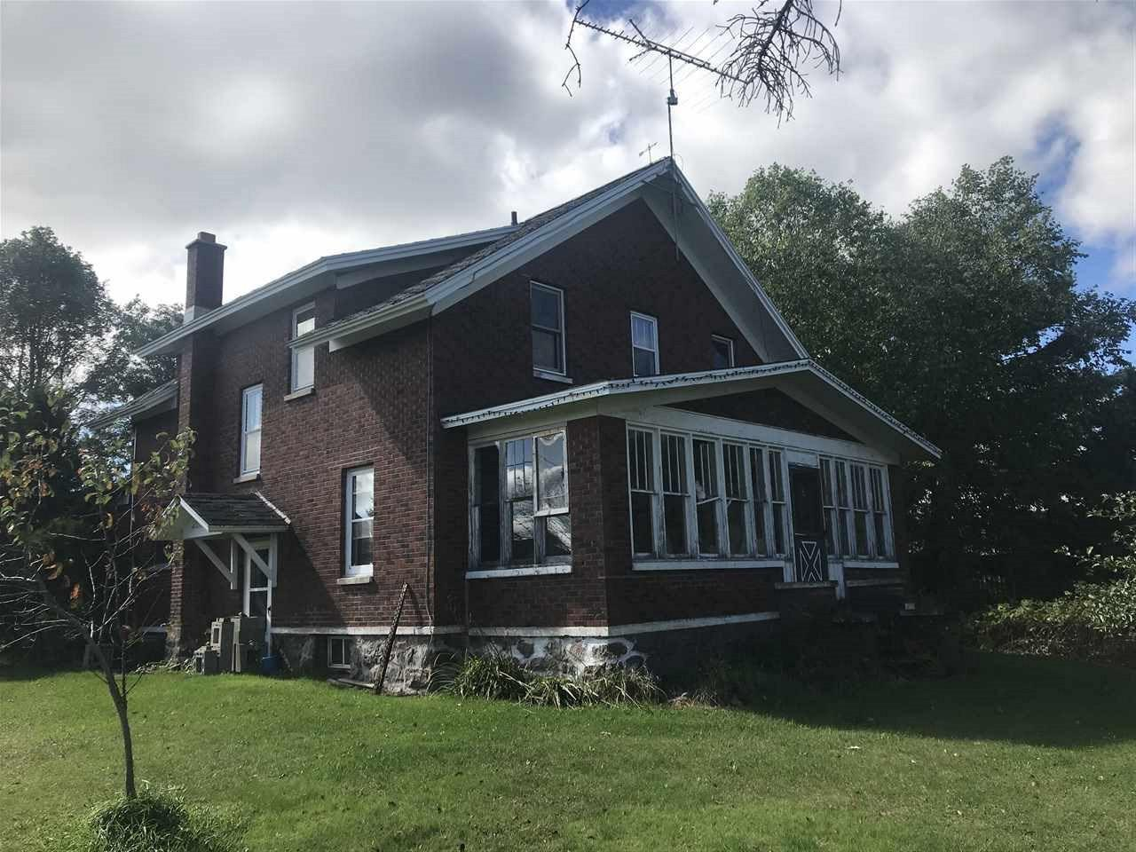 A must see. A nice brick farm house with a lot of character. Hardwood flooring under existing carpeting waiting to be renewed. Large rooms and lots of storage and walk in closets in all the bedrooms. Future bathroom roughed in on the 2nd floor. There is a 40x80 pole shed waiting for storage or to be your shop. There is a large barn in need of a little TLC but perfect for raising horses or cattle with a large concrete slab in the back to fence your animals in. Lots of fruit trees as well as berry bushes.,This is a perfect hobby farm to raise a family and enjoy the beautiful outdoors.  Reduced!  Sellers say sell!  Price is negotiable!