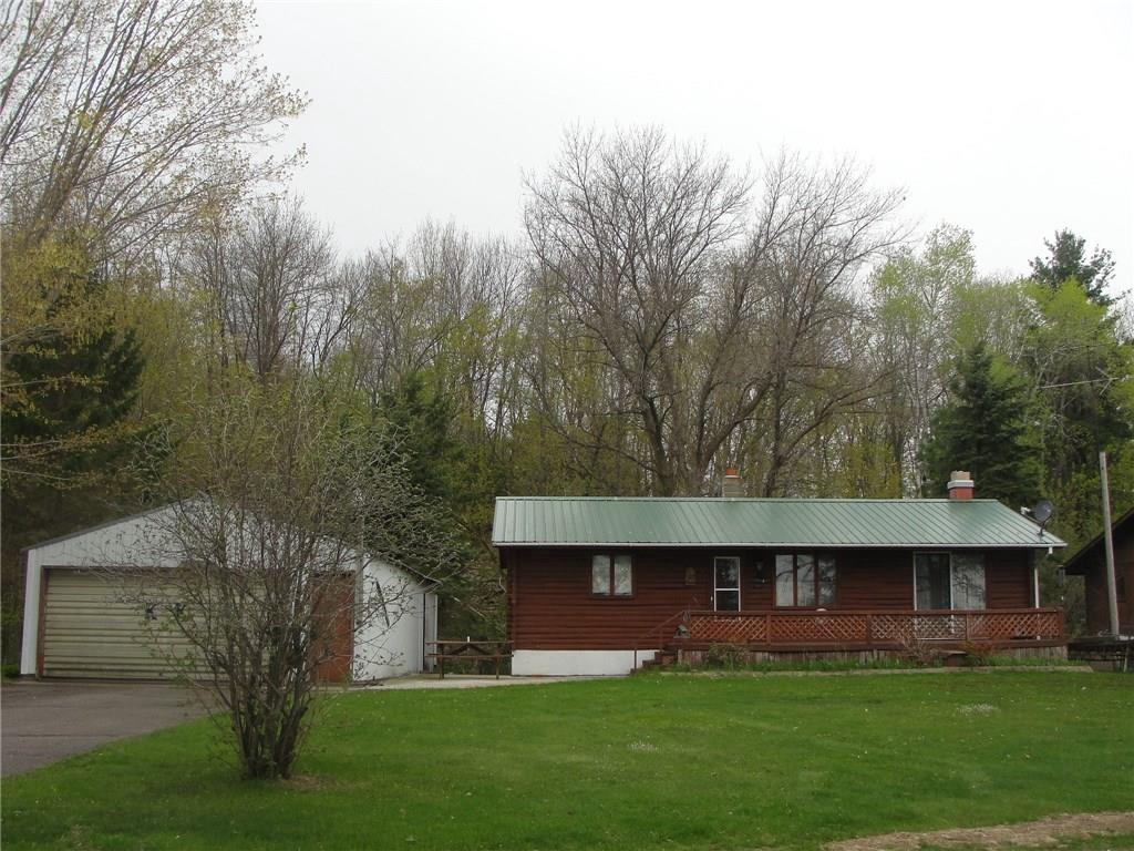 Cute 2 bedroom home/cabin on beautiful Spirit Lake with sandy shoreline. Home features wood log exterior, mostly wood interior for the Up-North feel, great views from the living room and deck. Full walk-out basement and large garage! Spirit Lake is a great fishing and recreation lake.