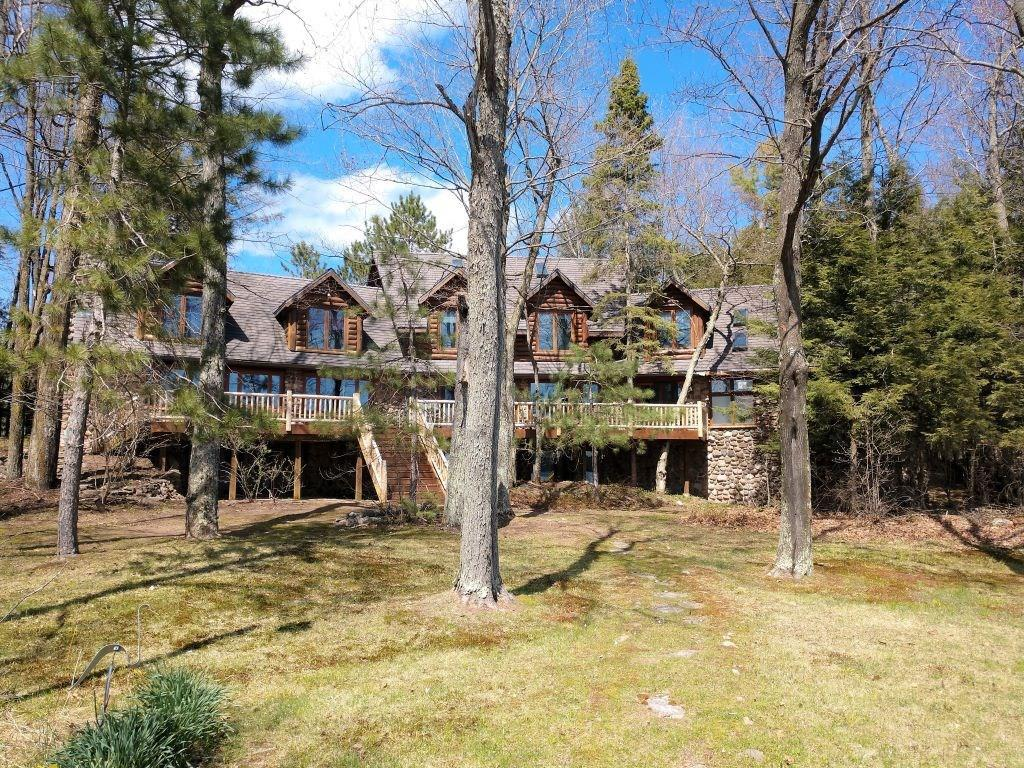 Large vacation home which can be converted to a bed & breakfast, or a company retreat or your own piece of the Northwoods.  Beautiful piece of property along with an extra lot next to the home for a total water frontage of 315 feet.