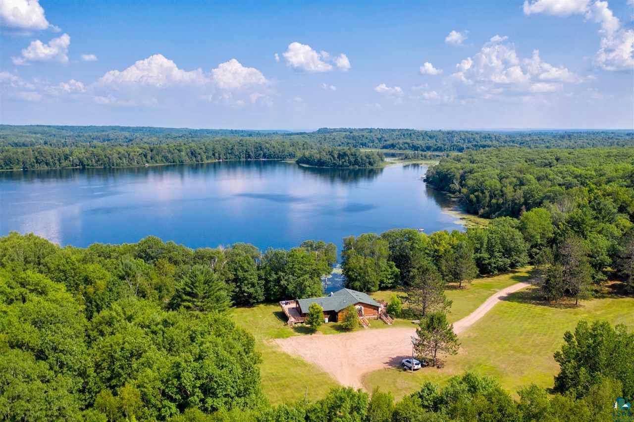 SCENIC DRIVE is an exceptionally well kept ?picture perfect? RESORT, and shows the PRIDE of ownership by the retiring owners.This Family-Ran Resort of 30years offers an excellent opportunity to LIVE and WORK, w/o having to leave home.Or, use as a private get-away!This outstanding opportunity offers 2 successful businesses in 1! RESORT sits on approx 26.5acres. Residence/Lodge/Restaurant-Bar/Grill and all 5 Cabins have Lake Delta views, includes 1,150 of waterfront footage.As you enter this ?SCENIC? resort, enjoy breathtaking views of wooded mature trees, rolling hills, grounds that are immaculate with plant gardens, wrap-around deck, patio seating, dock, play area, fire pits, water's edge lake views, and plenty of parking.There is directATV, snowmobile access and great FISHING! ALL-SEASON RESORT! OWNER'S HOME/LODGE-RESTAURANT-BAR-GRILL: The main Lodge/Residence was built in 2000, with true Northwood?s appeal in mind with log siding, and features a large open Great Room w/combined Kitchen and informal Dining Room with sliders out to wrap-around deck, a Butler?s Pantry, Mudroom with  Bath, 3 BDRMS, 1 Office/Den (or make this into another Bdrm), 2 full Baths, large Family Room, Laundry Room with commercial-sized washers and dryers, 2 Storage Rooms, and 1 Fireplace.The MA BDRM incl/private Master Full Bath w/Whirlpool and Walk-in Shower, and 2 large closets.The Kitchen/Dining area, Master BDRM, Family Room and Laundry Room all have walk-outs to lake. Lodge-Restaurant-Bar is full-service and has a ?true? Up-North feel.There are 2 () Baths, 2 Storage Rooms, all the equipment to run a successful business, incredible lake views, and tons of parking. Dining Room/Restaurant seats 17 at the bar, 28 seats at the tables, 14 chairs outside on the deck, if you want to add more, there is extra ?ground-floor? patio seating. Park your truck and ride from your cabin, the World starts at the end of the driveway! ATV, Side-X-Side or Snowmachine welcome! There are 5 Cabins, can be used year-round. HOMESTEAD CABIN: built in '19 as original home. Logs are original, w/complete re-design of interior, new foundation and heated slab completed in '93, 3 BDRMS. PENTHOUSE CABIN built in the 50?s, formerly the ?Old? bar, 2 BDRMS. COOKHOUSE CABIN built in '19, as farmstead?s summer Kitchen and eating area, bldg partial log and frame, 2 BDRMS. DUPLEX Cedars 1 and 2 CABINS: built 50?s, 2 BDRMS. BUILDINGS: Shed, heated Workshop, Fish Cleaning House, 1900-built chicken coop.