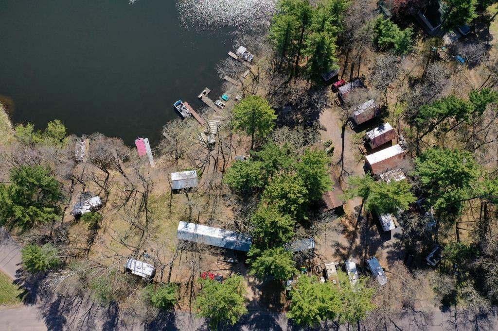 Have you ever dreamed of owning your very own resort?  Well here is your chance!  The Ginger Rogers Resort and Campground in Amery is for sale!  It sits on 7+ acres and has a 2 bed 1 bath main house, 6 rental cabins, 11 trailer spots, a rental trailer, 2 pontoons, 8 boats. There is also a huge shed 64x40 with a lean-to 64x18. This all sits right on the edge of the beautiful Apple River Flowage.  Call today for your showing!