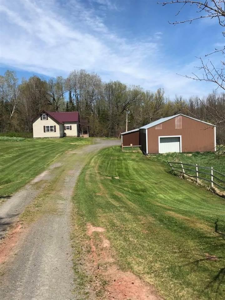 FLAGG RIVER VALLEY - PORT WING, WI - Remodeled 4 bedroom, 2 bath country home on 15 acres featuring over 500' (per seller) of frontage on a Class A Trout Stream, also features a small pond.  30x50 pole building (10' door, dirt floor with electrical).  New steel roof 2 years ago, well and septic replaced 5 years ago, newer windows and vinyl siding, updated electrical throughout.  All appliances, most furniture and home warranty are included.  Spend your days, hunting, fishing or enjoying nature.  Relax and enjoy your evening cocktails on the deck or in the jetted bathtub.