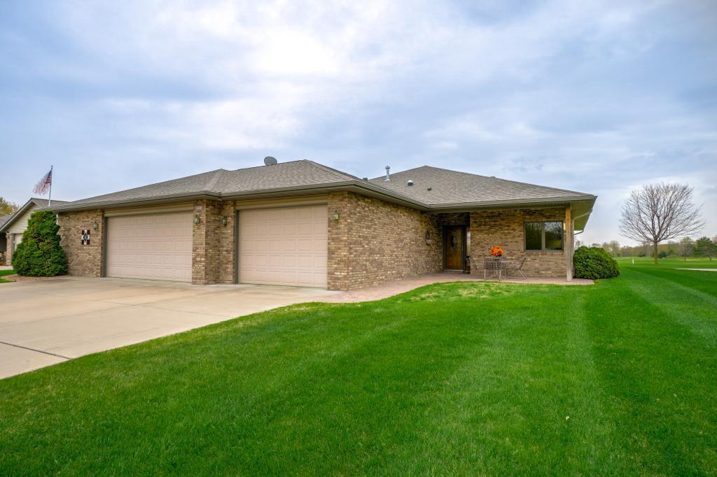 Remarkable 3 BR - 2 BA one level custom built home with 20x12 safe space basement situated on hole 14 on Amery Golf Course.  So many extra's in this quality built one level masterpiece.  Generous room sizes, tons of storage, open concept with neutral palette.  Custom kitchen cabinets with rollouts, center island, granite, tile, hardwood floors and in floor heat throughout main level.  Sunroom, beautiful owners suite with walk in closet, double sinks, jetted tub, walk in tiled shower.  Floor to ceiling stone fireplace with top of the line Quadra firewood insert $ an efficient clean burning heat source, Vaulted & 9 ft ceilings, surround sound inside and outside, high performance Andersen Windows with truseen screens to enjoy panoramic views.  Main floor laundry with tons of cabinets.  48x30 garage with additional deep 6x14 area to store boat.  Concrete driveway, minutes to Lake Wogasset and several other lakes.