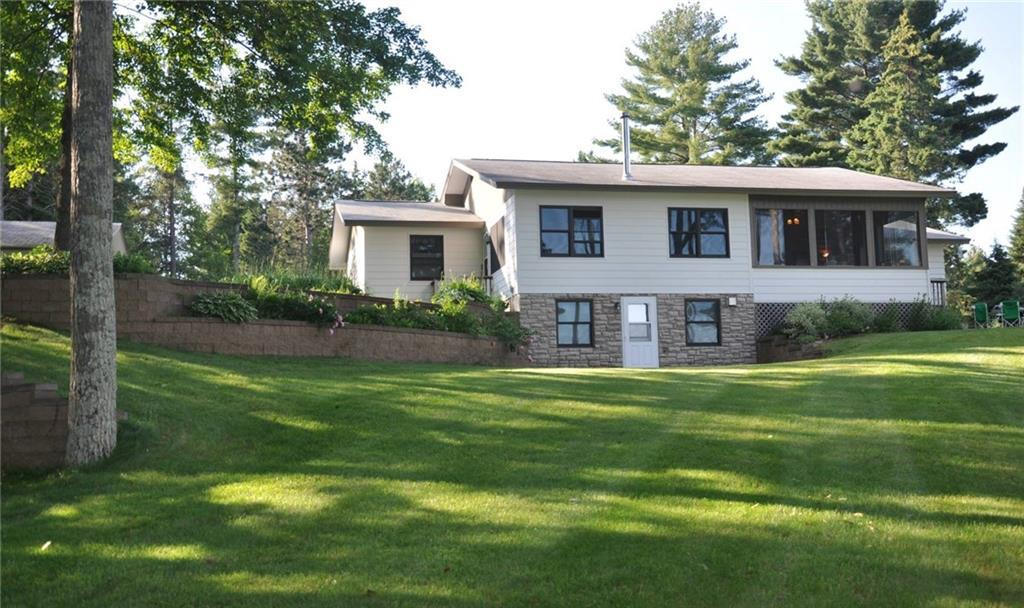 Lake Life is the Best Life. Delightful home with gorgeous view and amazing yard leading down to shore of Whitefish Lake. 3bedroom,2bath home with plenty of storage-pole shed & attached heated garage, storage shed & garden shed.Enjoy summer evenings out on the screened in porch.Cooler nights, cuddle up to a cozy fireplace. Plenty of room to entertain. Remodeled eat-in kitchen and separate dining room.Third bedroom serves guest quarters with own outdoor access. Gorgeous perennial gardens.