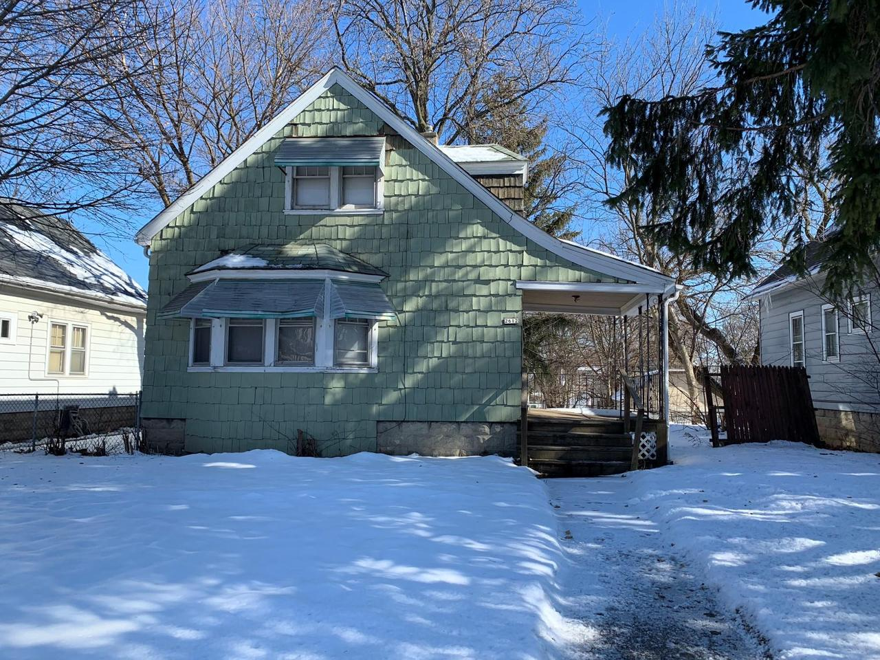 This single-family home needs TLC to shine again! Great potential and location. Original woodwork and wood floors remain but floors need work. There are 2 parking spaces off the alley in the back.
