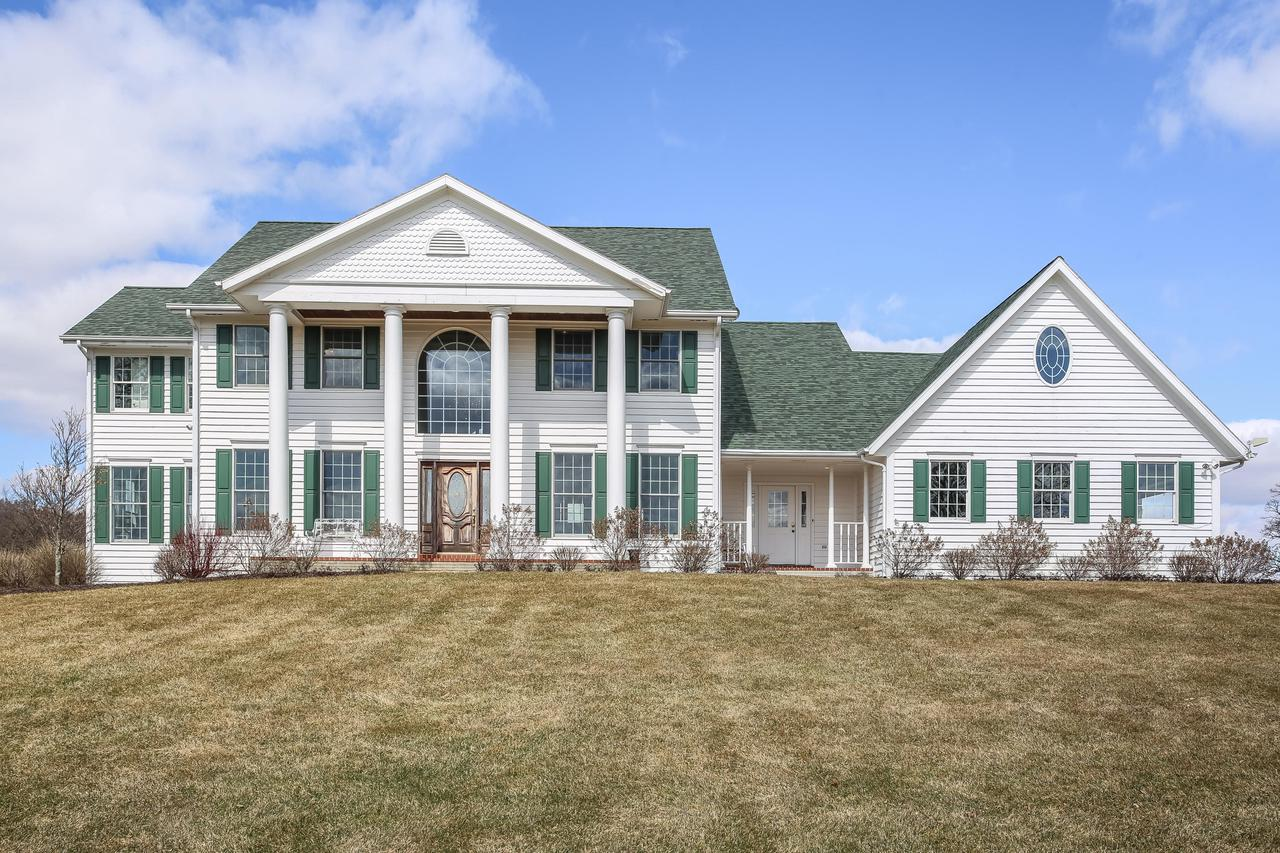 Here it is, the perfect retreat! This large inviting home has it all! Set on over 16 acres and close to the lake  this home boast 5 large bedrooms, a cheery sunroom, formal dining room, living room and open family room to the kitchen. Luxurious master suite with extremely large walk in closet. Spacious lower level game and recreation area with workout room and secondary kitchen. Walk out to the pool area and enjoy the quiet countryside. 3 fireplaces, 2 gas, one woodburning. 3 car attached garage and fantastic second garage/barn/workroom  with 3 bays 2 deep, heated, with a workroom and shop in the back. Roof replaced 2 years ago, new pool liner and automatic cover.Facetime Showing available.