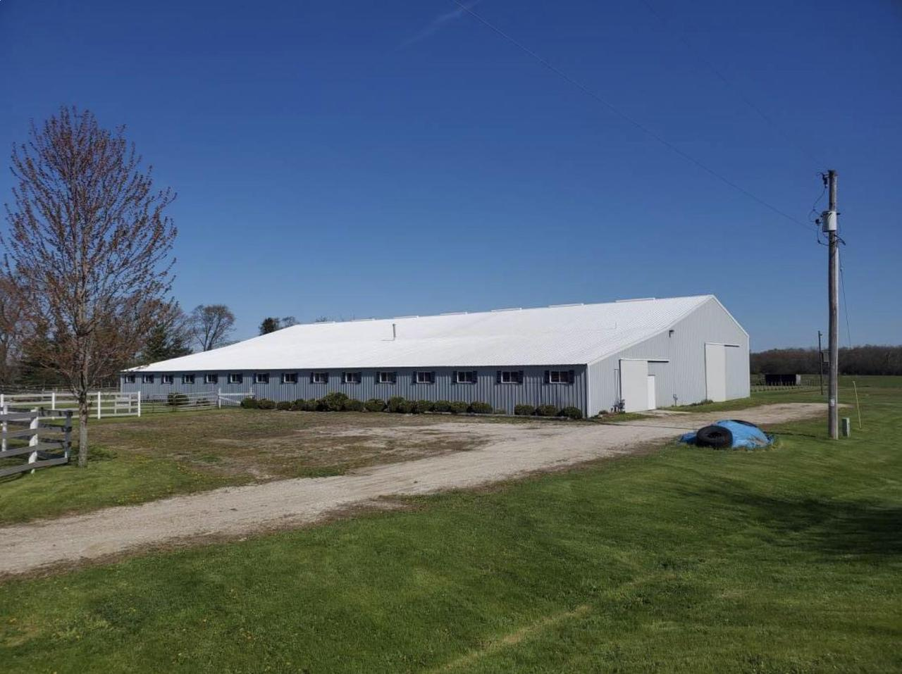 The perfect set up for commercial boarding, training, and/or breeding - Fully updated property in a prime location! 150x100 barn w/21 (heated) stalls-12 w/comfort mats, 2 tack rms, supply rm, grain rm, wash stall & grooming stall, 1/2 bath, 150x60 indoor arena & hay barn lean-too. 2 grass pastures w/shelters, hay field, 5 paddocks w/auto-waterers & no maintenance fencing. Additional 2 pastures easily converted to additional paddocks w/auto waterers. Rubber coated barn roof. House is totally updated w/wood floors throughout, 3 bedrooms, 2 fireplaces & separate quarters w/kit & 2 BRs. Conditional use on file for commercial operation. 24 flat, tree-lined acres! Call today for your showing.