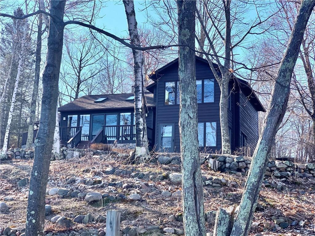 Privacy is the word with this 3-bed, 2-bath home on Big Sissabagama Lake on a dead end road. Cabin sits on 1.56 acres with 276? of frontage. The first thing you notice when entering the cabin is the beautiful Crab Orchid Flagstone flooring throughout the Kitchen and Livingroom. Enjoy a cup of coffee or a good book in the 3 season room attached to the kitchen. Lakeside livingroom with spectacular views of Sissabagama Lake features a beautiful stone fireplace. The Master bedroom has a large sitting area overlooking the lake. Lower level laundry room and family room with walkout to lake. Detached 2+ car garage provides great storage for your toys and a garden shed. Move in Ready property on Class A Musky Lake.