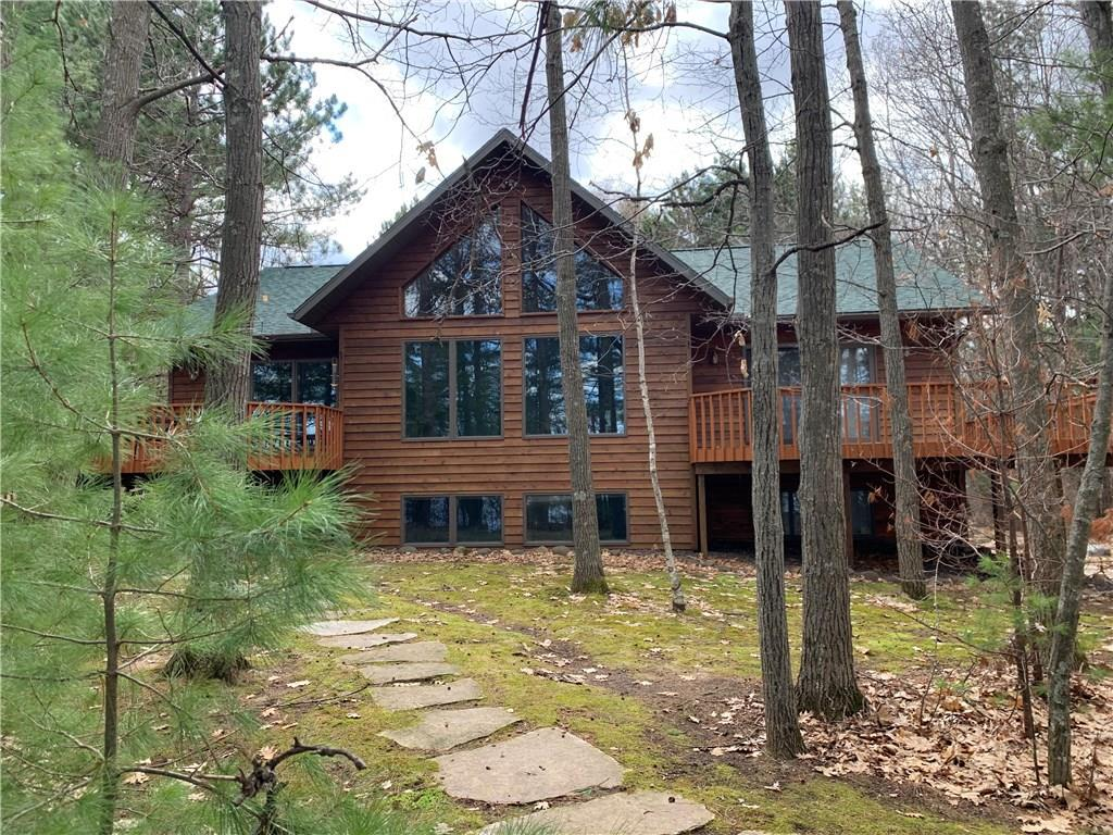 This immaculate lake home is ready for you to move in and start enjoying Whitefish Lake . Whitefish Lake is one of Wisconsin's finest lakes has outstanding water clarity & depth boat, ski, fish & swim.  This home is in like-new condition with beautiful lake views and a level approach to the water. Open concept kitchen and dining room, with wall of windows overlooking the lake, leading out to a large lake side deck. Beautiful 2 sided fireplace between living room and dining room.  Home has lofted ceilings, hardwood & tile floors, 5 beds & 3  baths.  Lower level family room is great for entertaining the entire family.   The 2 car attached garage & detached 2 car garage offer plenty of storage for all of your toys.   Enjoy breathtaking lake views, while being nestled back among mature trees and impeccable landscaping.  Get ready to make your own lake memories in this beautiful Whitefish Lake home!