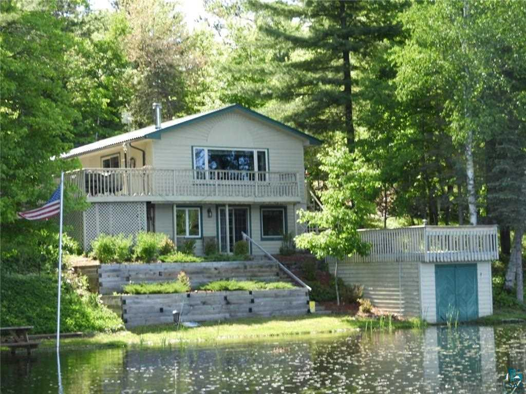 Remodeled home set on 5.2 acres of mature woods and overlooking 150 feet of sandy frontage on Deep Lake. You'll be ready for any season with a wood burning fireplace to warm you up on cold nights, central air to keep you cool on hot summer days and an indoor hot tub to soak your tired bones. The lake side boathouse stores lots of water gear and has a top side deck to relax on. More outside features include the paved driveway, the home's wrap-around deck and a gazebo. Storage for vehicles and toys is no problem with 2 detached garages and a 30' X 65' pole building. Appliances, dock and hot tub included! Two of the bedrooms are located on the walk-out level and do not have egress windows.