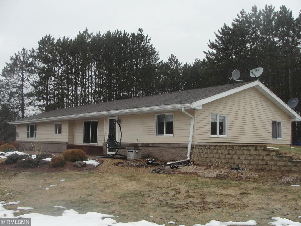 Awesome 4 bdr, 2 bath home on 8 private acres with a large garage/pole shed. Home features: vaulted ceilings, fireplace, ceramic tile flooring and newer carpet, open concept, one level living at its finest! You will be amazed by the beautiful setting overlooking a pond and ready for horses as well! Great place to raise your family or retire to! Call Today!